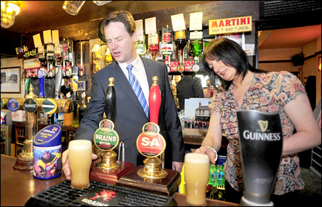 Nick Clegg pulls pints behind the bar with Licensee Elizabeth Smart