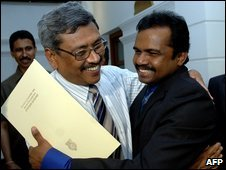 File photo of Gotabhaya Rajapakse (left) with a former Tamil Tiger warlord in Colombo, March 2009