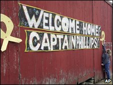 A huge 'Welcome Home' card posted on a barn across the street from the home of Richard Phillips
