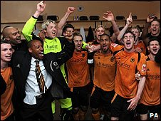 Wolves players celebrate after the match