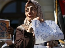A Palestinian woman calls for a boycott of Israel at a rally in Geneva ahead of the anti-racism conference, 18 April