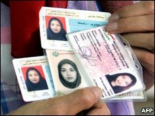 Roxana's mother holds her press cards at the family home in Tehran, 18 April