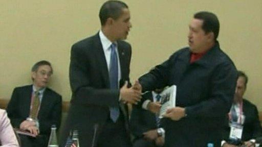 Venezuelan President Hugo Chavez greets  US President Barack Obama