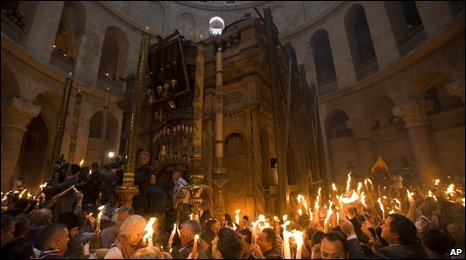 Christian pilgrims hold candles at the Church of the Holy Sepulcher, Jerusalem