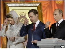 Dmitry Medvedev, center, his wife Svetlana, and Prime Minister Vladimir Putin in the Christ the Savior Cathedral in Moscow