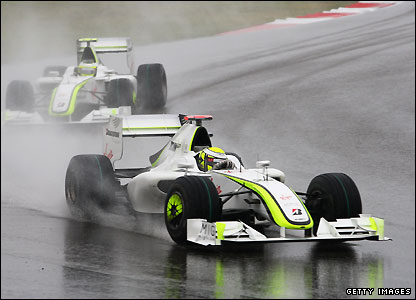 Jenson Button and Rubens Barrichello in the Shanghai rain