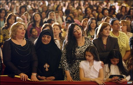 Egyptian women attend the Coptic Easter celebration Mass in Cairo on Sunday