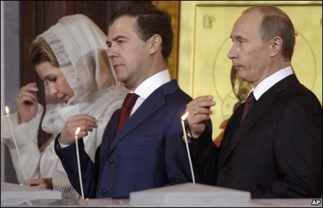 Russian President Dmitry Medvedev (centre), his wife Svetlana (left) and Russian Prime Minister Vladimir Putin (right) cross themselves during an Easter service in the Christ the Saviour Cathedral in Moscow on Sunday 19 April 2009