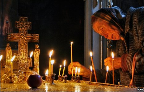 A Georgian woman lights a candle celebrating the Orthodox Easter in the capital Tbilisi on Sunday 19 April 2009