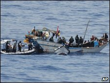 Dutch marine commandos with 20 fishermen that they freed from the Yemeni flagged dhow on 18 April 2009
