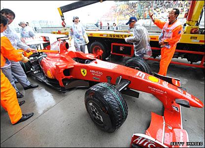 Felipe Massa's car is lifted off the track