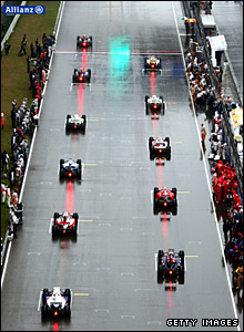 The cars line up at the start behind the safety car