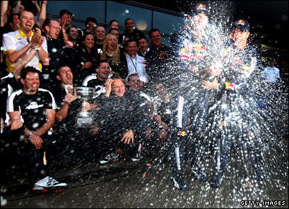 Mark Webber and Sebastian Vettel celebrate with their Red Bull team