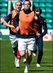 Rangers striker Kris Boyd limbers up ahead of the game