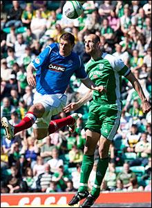 Rangers' Andrius Velicka (left) heads the ball away from Rob Jones