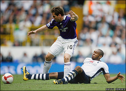 Newcastle striker Michael Owen is tackled by Wilson Palacios