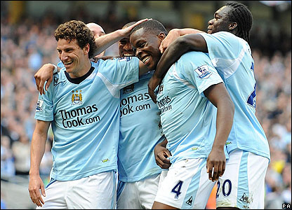 Nedum Onuoha is congratulated by his Man City team-mates