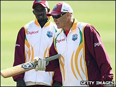Windies coach John Dyson (R) has arrived in England without a full squad
