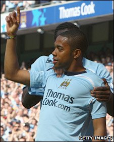 Robinho celebrates after scoring his first City goal since 28 December