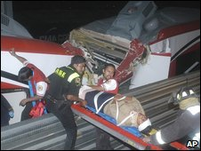 Rescue workers bring out a casualty