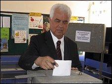 Dervis Eroglu casts his vote