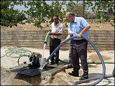 Communal water tank being filled