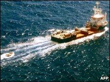 MV Pompei, towing a smaller vessel, thought to be a pirate boat, heading towards the Somali coast on 19 April 2009