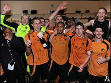 Wolves celebrate promotion after beating QPR