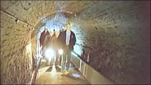 People walking through tunnel