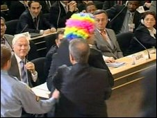 Protester being led out of Geneva conference, 20/04