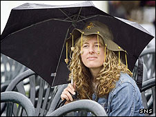 An Aussie fan fends off the Edinburgh rain