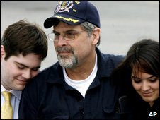Capt Richard Phillips (centre) hugs his children back in America on 17 April 2009