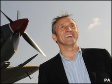 Steve Brooks next to a Spitfire similar to one he bought at auction for �1.7m