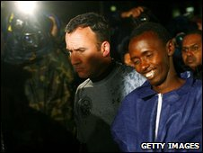 Abde Wale Abdul Kadhir Muse (right) arrives under custody in New York City on 20 April 2009