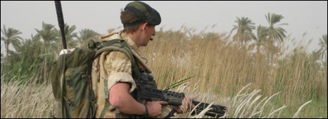 A British soldier on patrol in Iraqi village of Harat Qariya