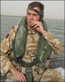 British soldier on boat on way to patrol an Iraqi village