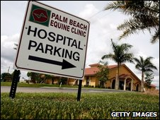 A sign stands outside the Palm Beach Equine Clinic