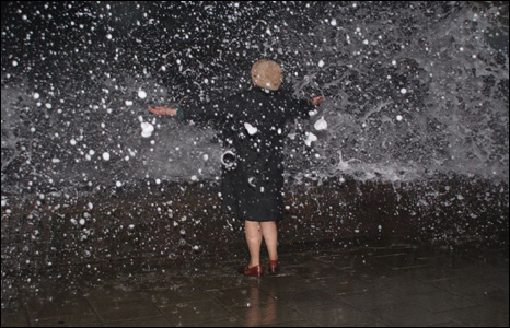 Simon Robinson's friend enjoys the waves breaking over the sea wall at Tywyn, Gwynedd, recently.