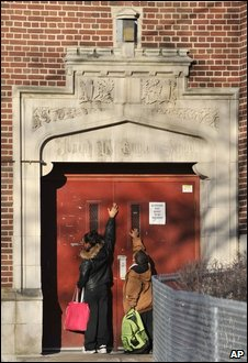Two early arrivals ring the bell at the front entrance to Guyton School in Detroit on Wednesday, April 8, 2009