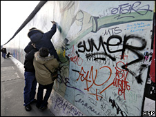 People add grafitti to the Berlin Wall (20 March 2009)