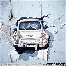 Painting of Trabant bursting through the Berlin Wall (