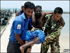 An image released by the Sri Lankan Navy, which it says shows a Tamil being helped by soldiers after fleeing fighting