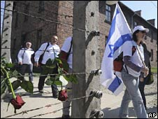 A participant carries an Israeli flag during a march at Auschwitz