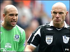 Tim Howard and Howard Webb