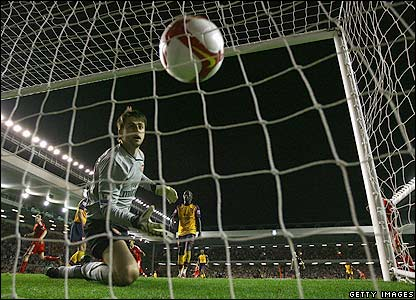 Fabianski watches as the ball finds the back of the net