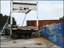 The remains of the lorry alongside the anti-terror truck wall which is intact