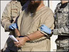 Military guards escort a detainee at Guantanamo Bay (file image)
