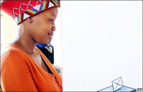 A woman prepares her ballot