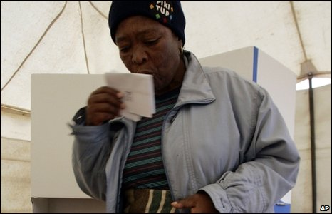 Woman kisses her ballot in Soweto polling station