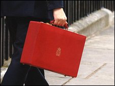 Unidentified person carrying a budget box